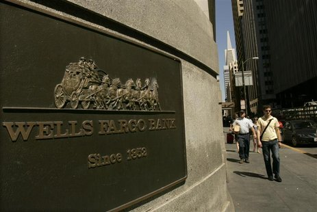 A pedestrian walks past a Wells Fargo & Co bank in San Francisco