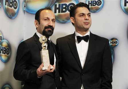 "Director Farhadi and actor Moadi pose with the award for best foreign film for ""A Separation"" as they arrive at the HBO after party after at"