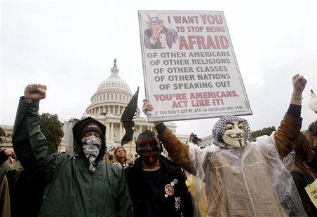 Occupy Congress/DC protesters hold up a sign in front of the U.S. Capitol during a rally in Washington