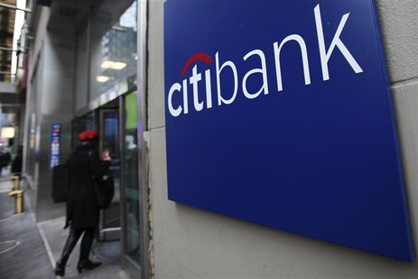 A woman walks into a Citibank branch in New York