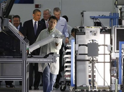 U.S. President Barack Obama receives tour of a manufacturing facility in North Carolina