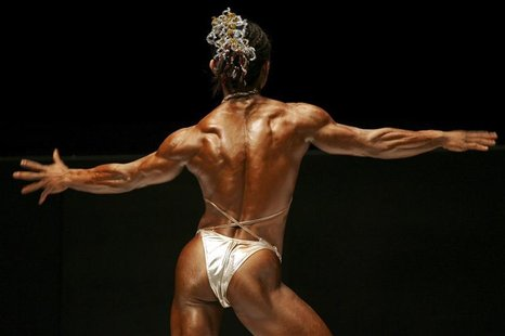 A female bodybuilder competes during the Hong Kong Bodybuilding Championships