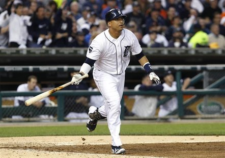 Detroit Tigers' Victor Martinez watches his RBI triple against the Texas Rangers in Game 5 in their MLB ALCS baseball playoffs in Detroit