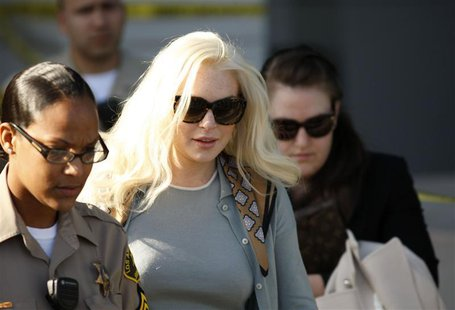 Actress Lindsay Lohan leaves the court after a progress report hearing in Los Angeles.