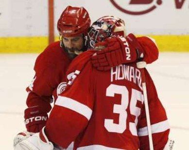 Detroit Red Wings right wing Todd Bertuzzi (44) hugs goalie Jimmy Howard (35) after a win. REUTERS/Rebecca Cook