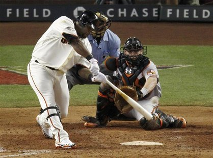 National League's Sandoval hits an RBI ground rule double against American League during MLB's All-Star Game in Phoenix