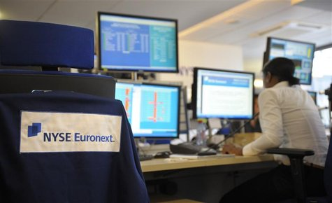 An expert works at her screens in the NYSE Euronext cash market operations room in Paris