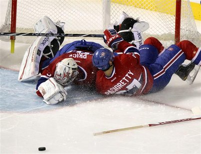 Canadiens Pacioretty collides with goalie Price during third period NHL hockey action against Capitals in Montreal.
