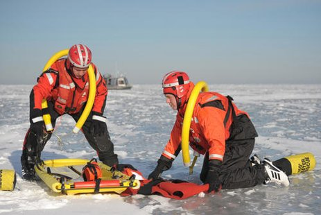 Petty Officer 2nd Class Nick Schierberg and Seaman Grant Jansen, both of Coast Guard Station Sturgeon Bay, Wis., simulate evacuating a victim during a mass rescue operations preparedness exercise at Red River County Park, Jan. 18, 2012.