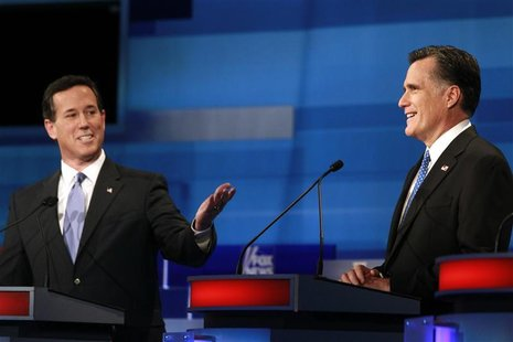 Republican presidential candidate (L) former U.S. Senator Rick Santorum (R-PA) makes a point as former Massachusetts Governor Mitt Romney li