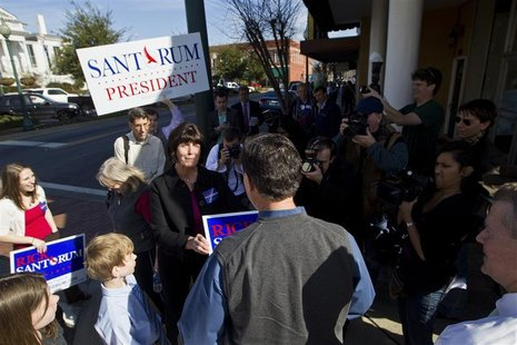 Republican presidential candidate and former Senator Rick Santorum greets supporters outside before a Faith, Family and Freedom Town Hall at