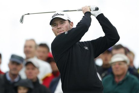 Branden Grace of South Africa watches his tee shot during the second round of the British Open Golf Championship at the Turnberry Golf Club