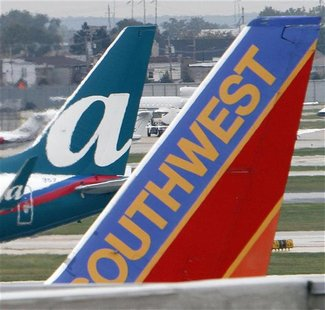 AirTran and Southwest Airlines jets sit on the tarmack at Midway International airport in Chicago