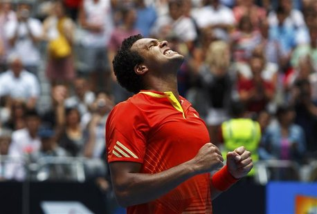 Tsonga of France celebrates after defeating Gil of Portugal in their match at the Australian Open tennis tournament in Melbourne