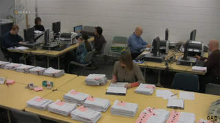 Screen shot taken Jan. 20, 2012 from a webcam showing Wisconsin Government Accountability Board employees verifying recall petitions against Gov. Scott Walker.