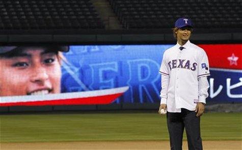 The Rangers introduce pitcher Darvish at a media conference at Rangers Ball Park in Arlington, Texas