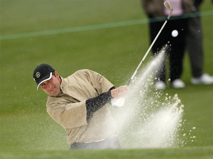 Jose Maria Olazabal of Spain hits from a sand trap on the second hole during a practice round for the 2009 Masters golf tournament at the Au