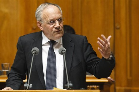 Swiss Economy Minister Schneider-Ammann speaks during an extraordinary Parliament session on the Swiss Franc in Bern
