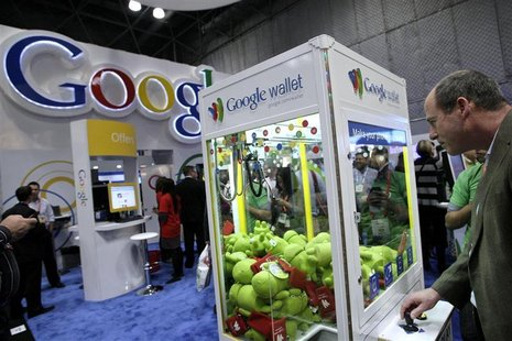 A man visits the Google stand at the National Retail Federation's Annual Convention and Expo in New York