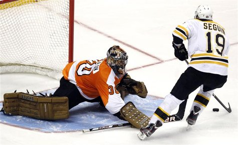 Bruins Seguin shoots the game winning goal past the Flyers goalie Bryzgalov during the shootout period of their NHL ice hockey game in Phila