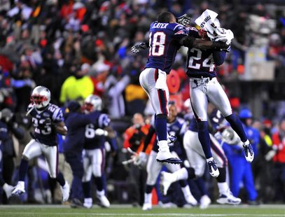 New England Patriots free safety Slater and teammate Arrington celebrate after the Baltimore Ravens missed a field goal in the closing secon