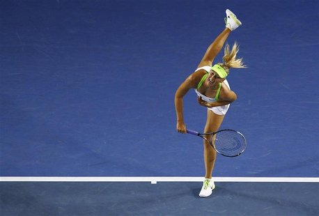 Sharapova of Russia serves to Lisicki of Germany during their match at the Australian Open tennis tournament in Melbourne