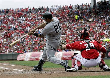 New York Yankees' Posada hits a two run home run off of Cincinnati Reds' Leake during their interleague MLB baseball game in Cincinnati
