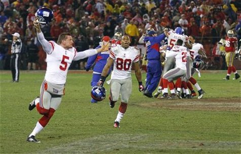 New York Giants holder Weatherford celebrates with teammates including Cruz after the Giants defeated the San Francisco 49ers in the NFL NFC