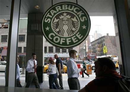 File photo of people walking past the Starbucks outlet on 47th and 8th Avenue in New York