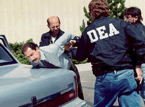 The DEA in a Trafficker bust By Rad Racer at en.wikipedia [Public domain], from Wikimedia Commons