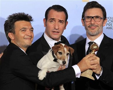 "Langmann, Dujardin and Hazanavicius of the film ""The Artist"" pose backstage at the 69th annual Golden Globe Awards in Beverly Hills"
