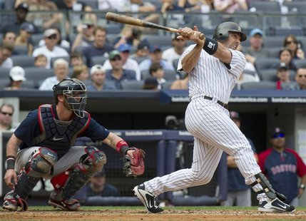 New York Yankees Jorge Posada hits two-run home run in front of Boston Red Sox Jarrod Saltalamacchia in their MLB game in New York