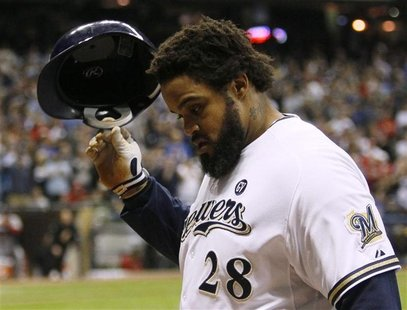 Milwaukee Brewers first baseman Prince Fielder walks back to the dugout after grounding out to the St. Louis Cardinals in the 8th inning in