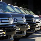 Ford Flex vehicles are lined up for sale at a Ford dealership in Tustin