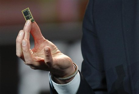 Vestberg, president and CEO of Ericsson Group, holds a ST-Ericsson 4G LTE chip during his keynote address at the 2012 International CES in L