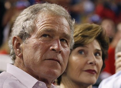 Former U.S. President George W. Bush and former first lady Laura Bush watch Game 1 of the MLB American League Championship Series baseball p
