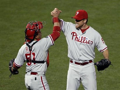 Phillies closer Lidge celebrates with catcher Ruiz after defeating the Giants in Game 5 of their Major League Baseball NLCS playoff series i