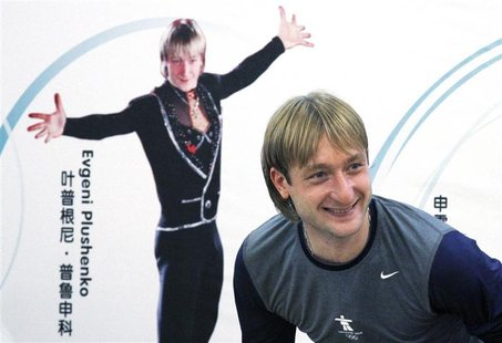 Former Olympic champion figure skater Plushenko of Russia smiles as he leaves a news conference in Beijing