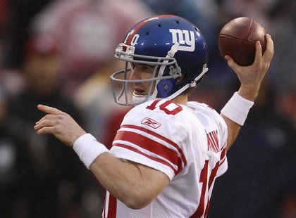 New York Giants quarterback Manning throws a pass against the San Francisco 49ers in the first quarter during the NFL's NFC Championship gam