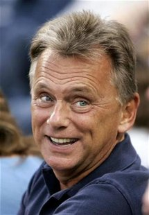 Television personality Pat Sajak smiles before the Los Angeles Dodgers play the Philadelphia Phillies in Major League Baseball's NLCS in Los