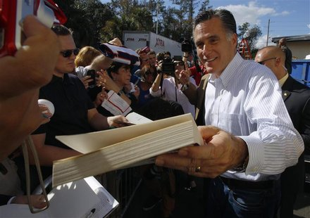 Republican presidential candidate and former Massachusetts Governor Mitt Romney signs autographs during a campaign stop at Paramount Printin
