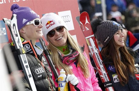 Hoefl-Riesch, Vonn and Weirather follows the race after competing in the the women's Alpine skiing World Cup downhill race in the Swiss moun