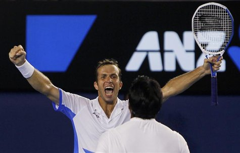 Stepanek of Czech Republic celebrates with his partner Paes of India after they defeated Bob and Mike Bryan of the United States