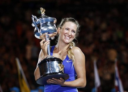 Azarenka of Belarus poses with her trophy after defeating Sharapova of Russia in their women's singles final match at the Australian Open in