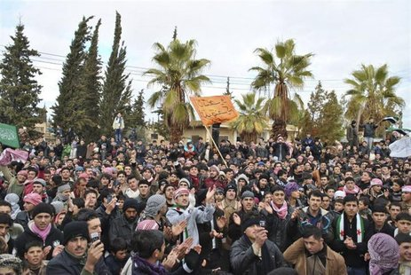 Demonstrators protest against Syria's President Bashar al-Assad in Jerjenaz, near Idlib