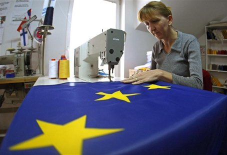 A seamstress sews a European Union (EU) flag in a small workshop in Belgrade