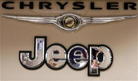 Pro Chrysler Jeep staff members are reflected in a sign at the Chrysler dealership during a meeting in Thornton