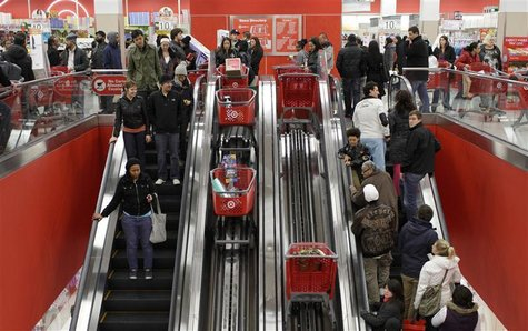 Shoppers ride an escalator at a Target Store in Chicago