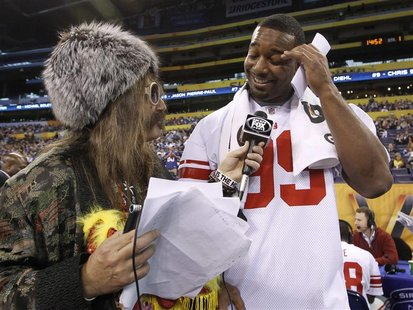 Giants defensive tackle Canty is interviewed during media day for the NFL Super Bowl XLVI in Indianapolis