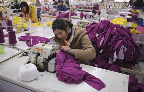 Employees work at a garment factory in Wuhu